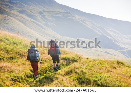 hikers team in the mountains. travel sport lifestyle concept - stock photo