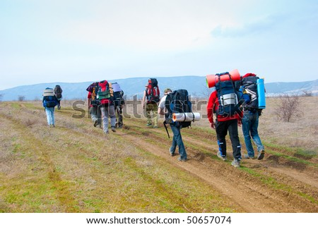 Hikers walk along the footpath - stock photo