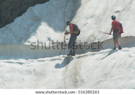 Hikers walking along on a track in the glacier.