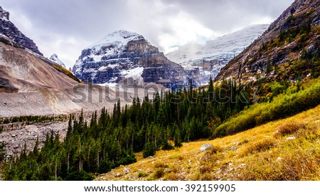 Hiking above the tree line to the Plain of Six Glaciers at Lake Louise in the Canadian Rocky Mountains - stock photo