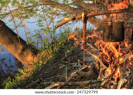 hiking and cooking in nature - stock photo