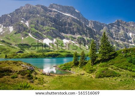 Hiking around Truebsee lake in Swiss Alps, Engelberg, Central Switzerland - stock photo