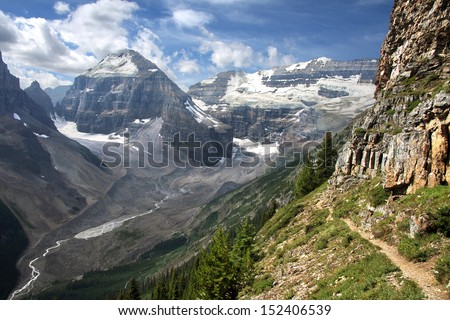 Hiking at Lake Louise, Banff National Park, Alberta, Canada The view looking from left to right, Mount Lefroy and Mount Victoria. The trail to the Devil's Thumb, a protrusion of Mount Whyte.  - stock photo