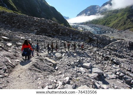 Hiking at the terrains to Fox Glacier - stock photo