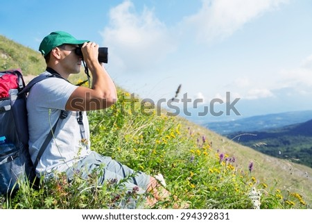 Hiking, Binoculars, Mountain. - stock photo
