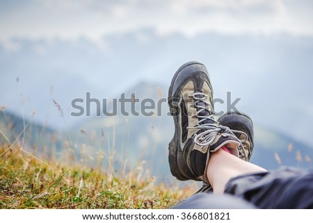 Hiking boot closeup in the mountains. Outdoor relaxation  - stock photo