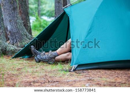 Hiking boot closeup on mountain  - stock photo