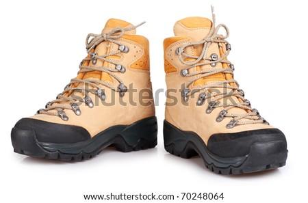 Hiking boot isolated on white background - stock photo
