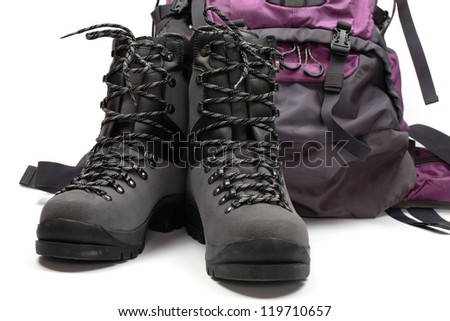 Hiking boots and bag, isolated on white