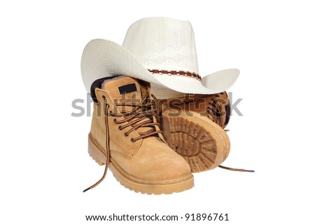Hiking boots and hat isolated over white with clipping path. - stock photo
