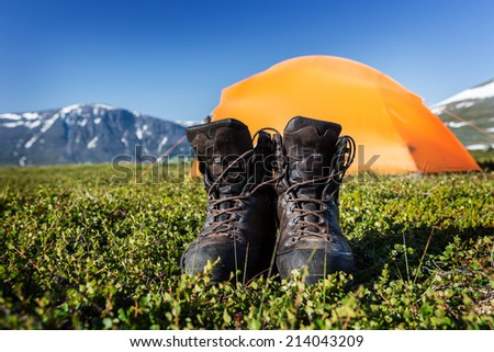 Hiking Boots and Tent - stock photo
