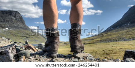 Hiking boots between the Lapporten in northern Sweden - stock photo