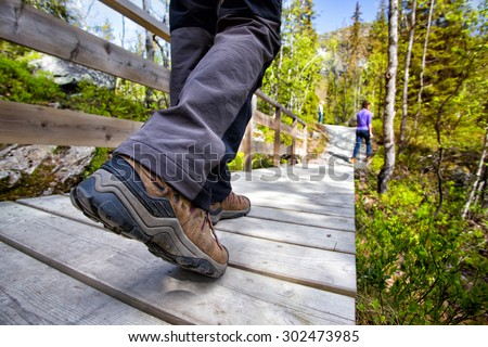 hiking boots close-up. tourist walking on the trail. Norway  - stock photo
