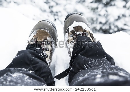 Hiking Boots in the Snow on Winter Time - stock photo