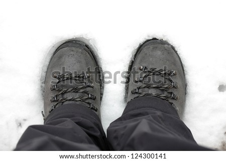 Hiking boots on snow, top view - stock photo