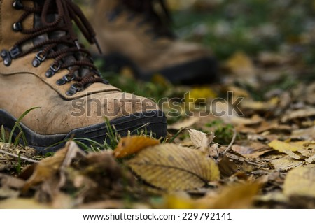 hiking boots on the forest floor - stock photo