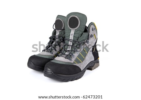 Hiking boots on white background - stock photo