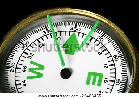 Hiking compass pointing north - stock photo