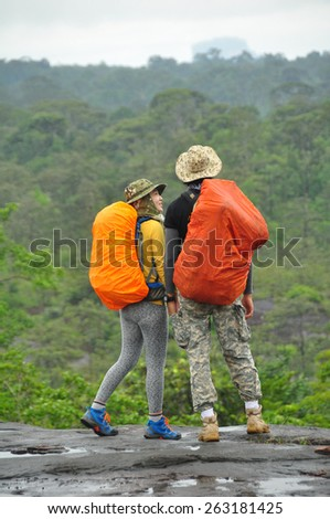 Hiking couple in forest - stock photo