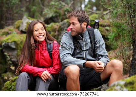 Hiking couple. Young people hikers having fun outdoors in forest. From La Caldera, Aguamansa, La Orotava, Tenerife, The Canary Islands, Spain. - stock photo
