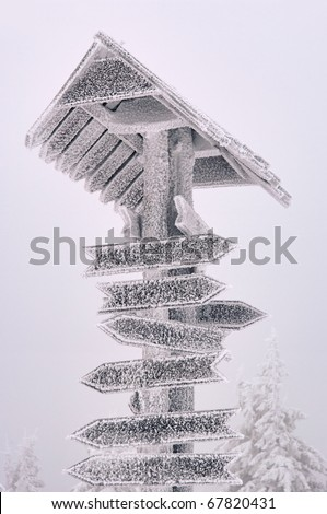 hiking direction sign in snow - stock photo