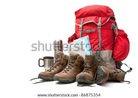 hiking equipment, rucksack and boots. Concept for family hiking - stock photo