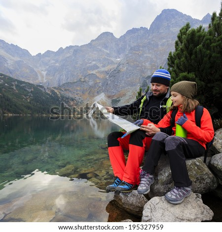 Hiking - family adventure on mountain trek - stock photo