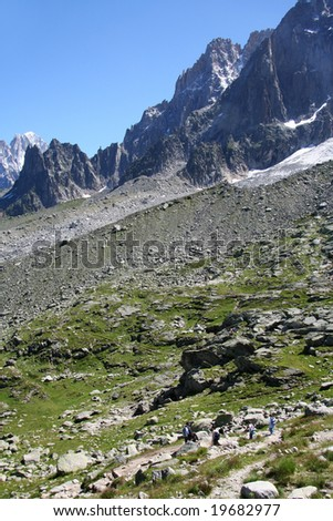 Hiking 6,000 ft altitude to Montenvers on the Mont Blanc massif, Chamonix, France - stock photo