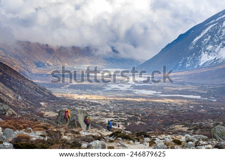 Hiking group on a trail. Sagarmatha National Park, Nepal, Himalayas  - stock photo