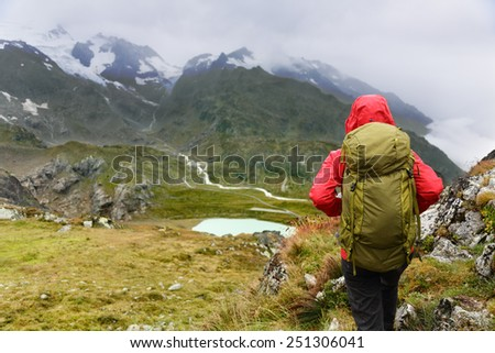 Hiking - hiker woman on trek with backpack living healthy active lifestyle. Hiker girl walking on hike in mountain nature landscape in Steingletscher, Urner Alps, Berne, Swiss alps, Switzerland. - stock photo