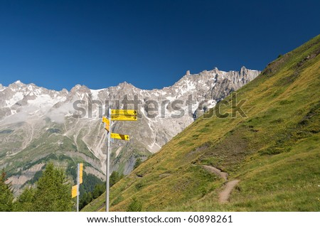 hiking in Ferret valley near Courmayeur, Aosta valley, Italy - stock photo