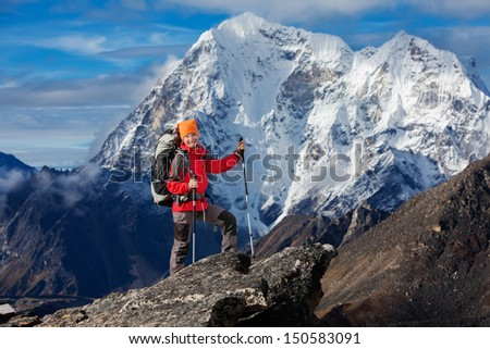 Hiking in Khumbu walley in Himalayas mountains - stock photo
