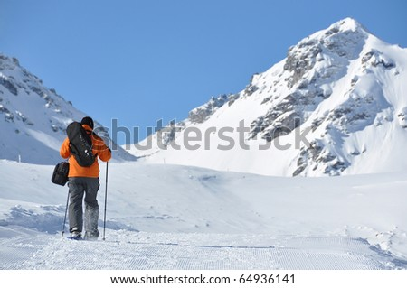 Hiking in snowshoes along the mountain track - stock photo