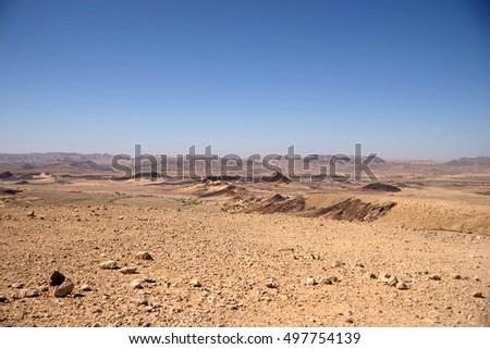 Hiking in stone desert mountain landscape of Israel