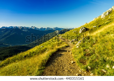 Hiking in the Alps - stock photo