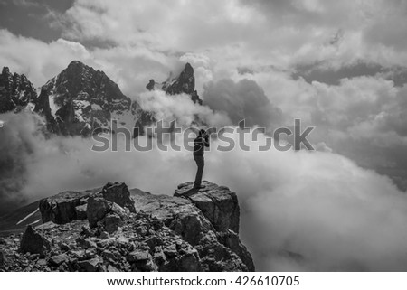 Hiking in the clouds. I took the risk but it was so amazing from the top, such an amazing view - stock photo