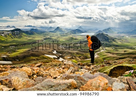 Hiking in the incredible jurassic wild landscape of green mountains, among glaciers and volcanoes - stock photo