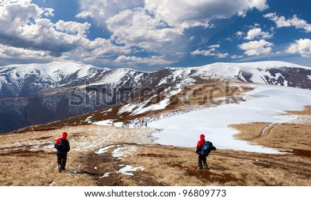 Hiking in the mountains in early spring - stock photo