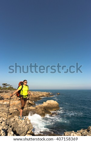 Hiking in the national park along the sea in the summer.