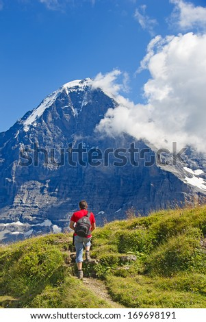 Hiking in the swiss alps. Mount Eiger in the Jungfrau region - stock photo