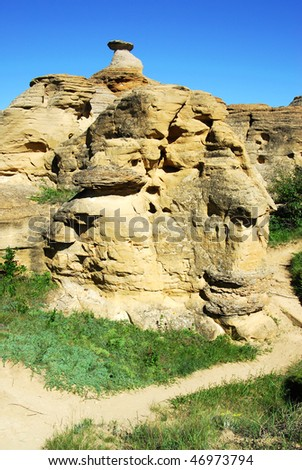 hiking in trail inside the hoodoos and sandstones field at the writing on stone provincial park, alberta, canada.