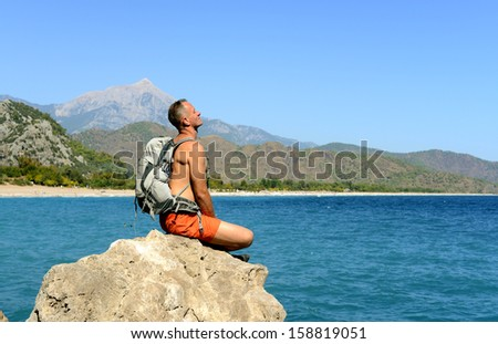 Hiking in Turkey. Lycian Way. Backpacker by the sea. The track is completed - stock photo
