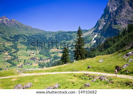 Hiking near Grindelwald in the Canton of Bern in Switzerland - stock photo