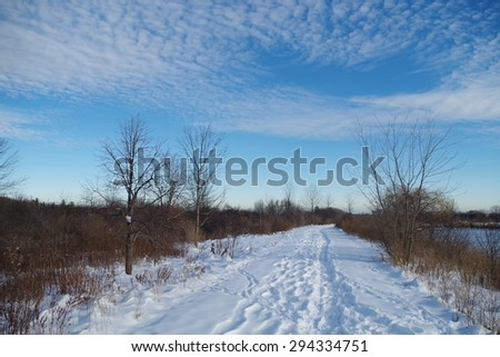 hiking on a winter trail  - stock photo