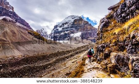 Hiking on the Trail to the Plain of Six Glaciers in Banff National Park in the Canadian Rocky Mountains - stock photo