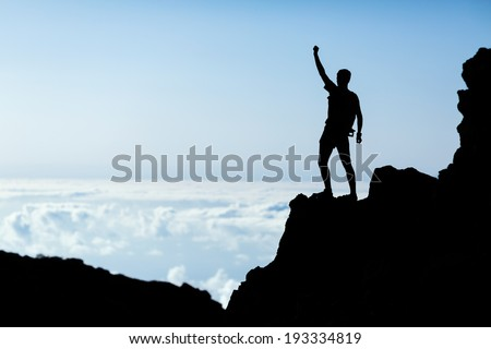Hiking or running accomplish silhouette, man backpacker, success victory in mountains. Fitness and healthy lifestyle outdoors in summer nature on La Palma, Canary Islands - stock photo