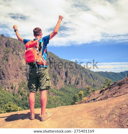 Hiking or trail running man in mountains. Happy adventure backpacker hiker success. Motivation inspiration concept, fitness and healthy lifestyle outdoors in summer nature, La Palma on Canary Islands. - stock photo