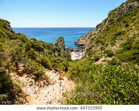 Hiking path on the way down to Praia da Ribeira do Cavalo, beautiful remote beach in Sesimbra, Portugal