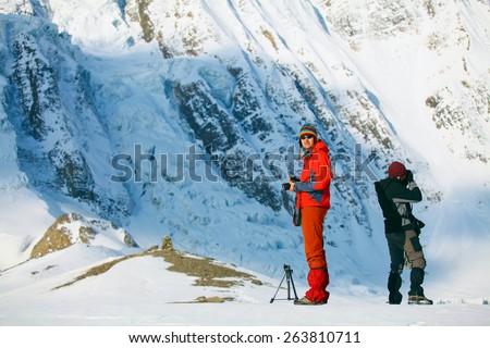Hiking photographer taking pictures. Trek around Annapurna mount.  - stock photo
