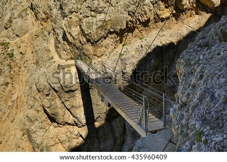 Hiking route through a bridge in the Alps - stock photo